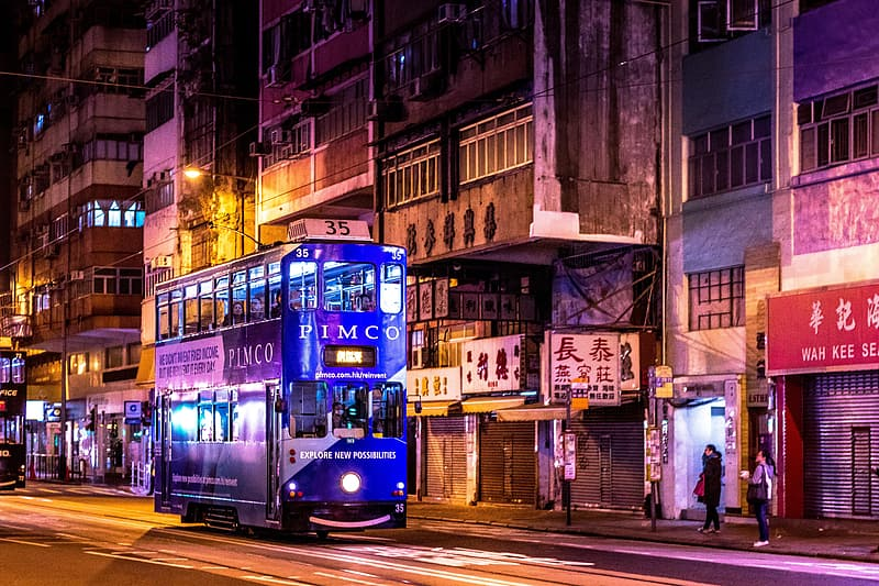 Blue and white tram on street during night time