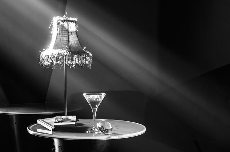 Grayscale photography of cocktail glass on table