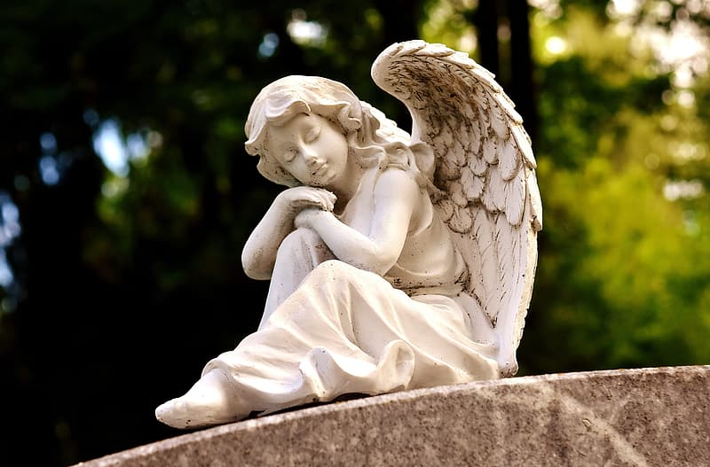 Female angel sleeping statue
