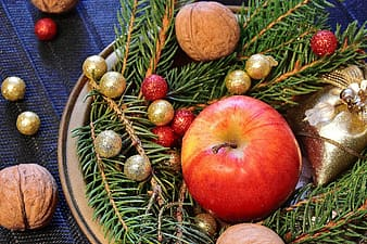 Photo of apple fruit surrounded by baubles