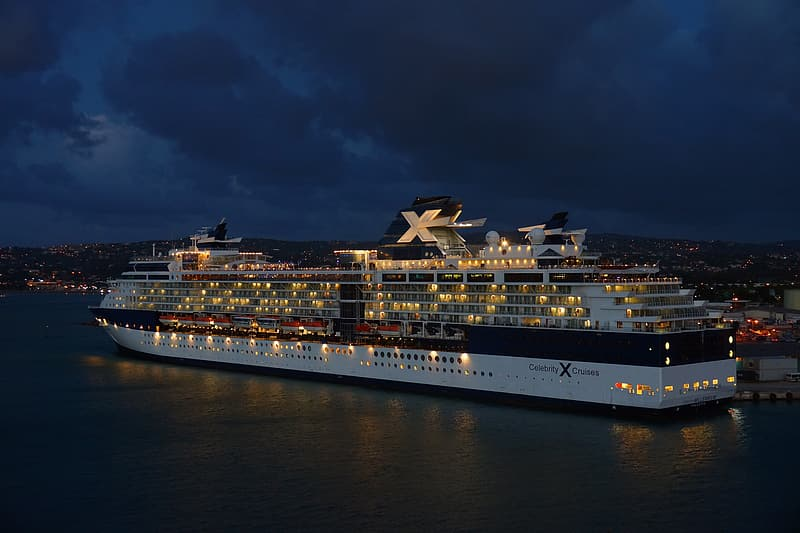 Photography of white and black cruise during nighttime