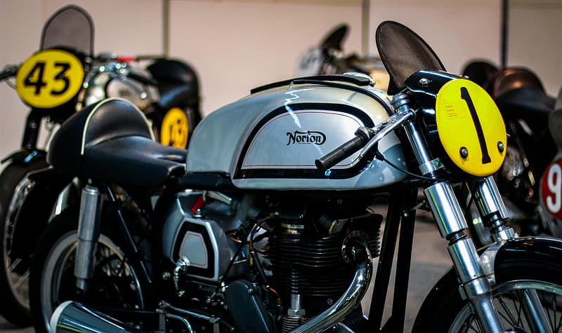 Gray and black motorcycle besides no 43 motorcycle