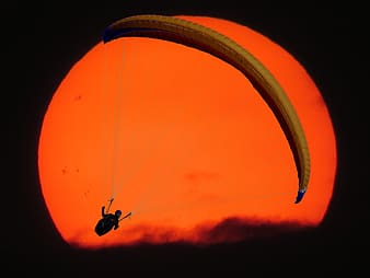 Person in parachute with full moon background illustration