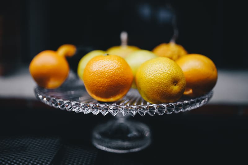 Orange fruits on clear glass bowl