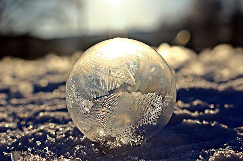 Focus photo of round clear glass ball