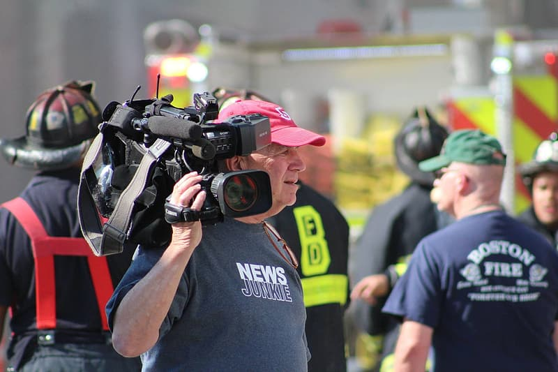 Man carrying professional video camera