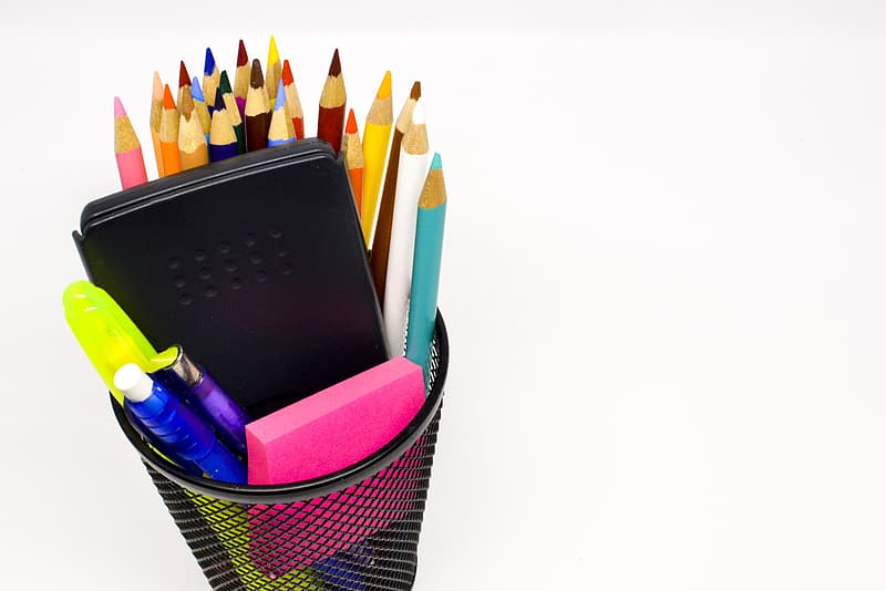 Assorted-color colored pencils on black mesh can