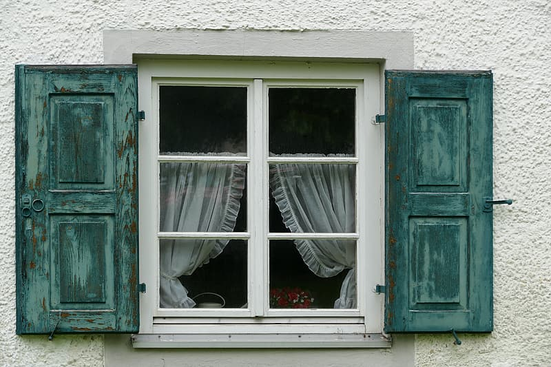 White and green wooden window