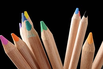 Assorted-color coloring pencils with black background