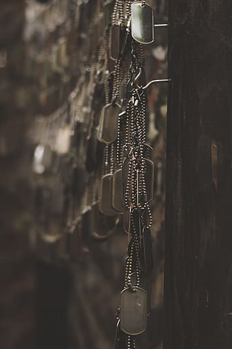 Silver chain link on brown wooden surface