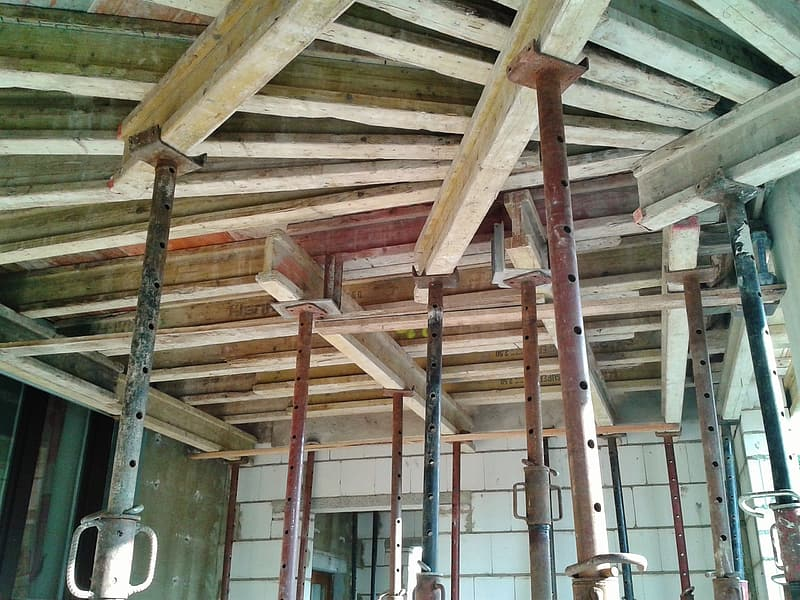 Low angle-view of metal bars hanged on ceiling