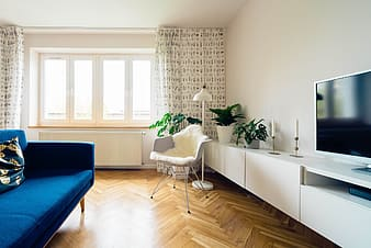 White sofa chair beside white wooden table