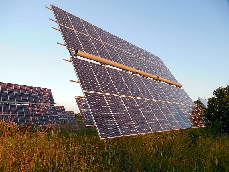 Solar panel surrounded with green grass