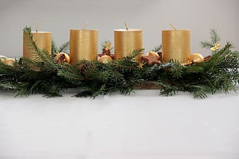 Four gold pillar candles