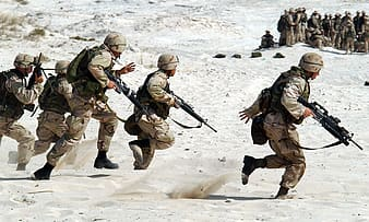 Soldiers on white sand at daytime