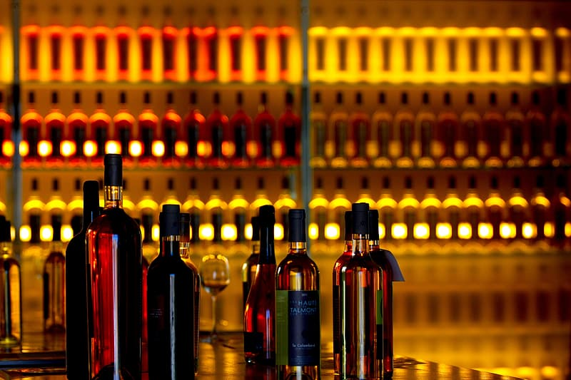 Liquor bottles near bottles on rack