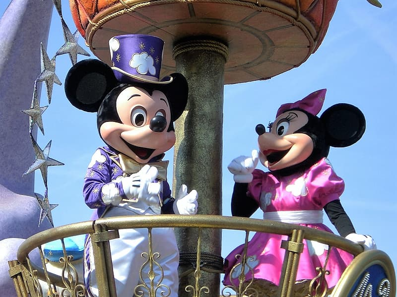 Disney Mickey and Minnie Mouse mascots under blue sky