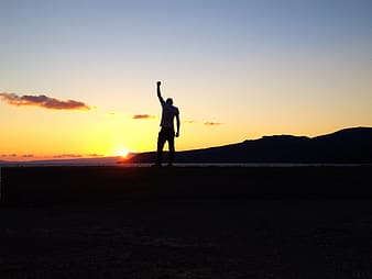 Silhouette of man on sunset