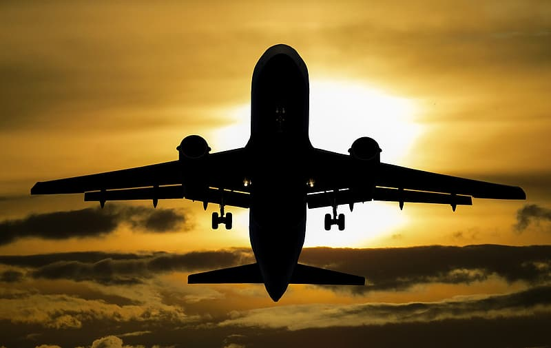 Silhouette photography of airplane during golden hour
