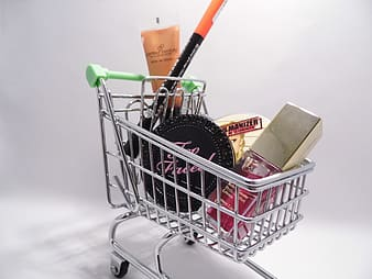 Shopping cart with assorted cosmetics inside