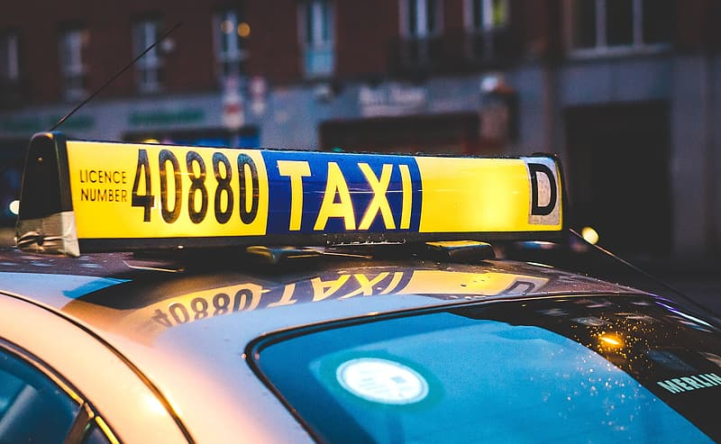 Yellow and blue taxi light signage