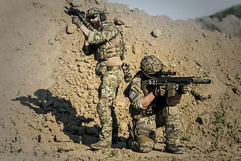 Two army holding rifles