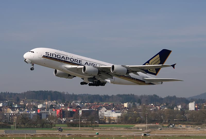 White Singapore Airlines airplane taking off at daytime