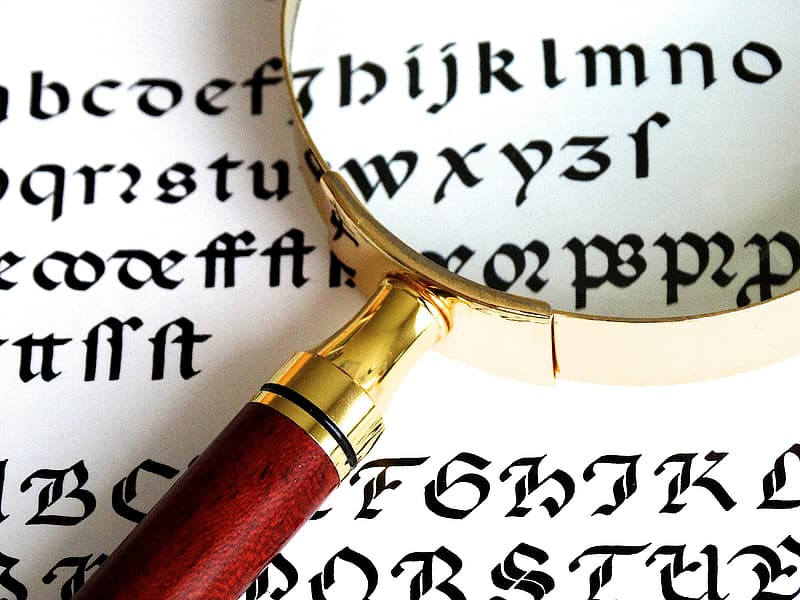 Brown magnifying glass with white text