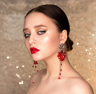 Woman wearing red chandelier earrings