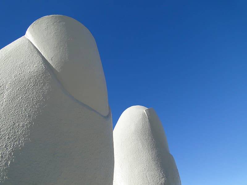 Gray heart shaped stone under blue sky during daytime