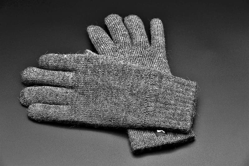 Gray knit gloves on gray textile