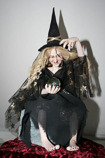 Witch holding ball figurine