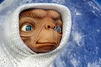 Brown alien with white scarf