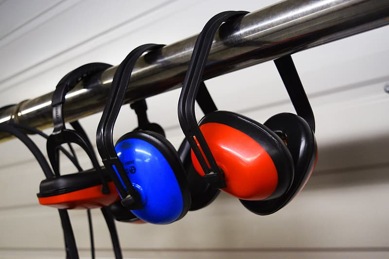 Two red and one blue noise-cancelling headphone