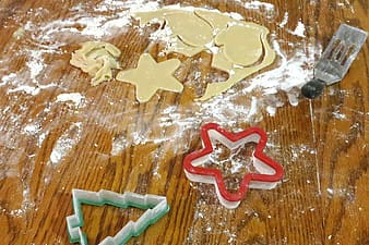 Cookie cutters on brown wooden surface
