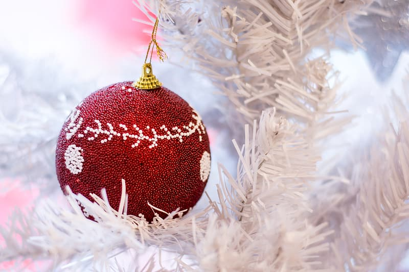 Red and gray bauble hanging on white Christmas tree