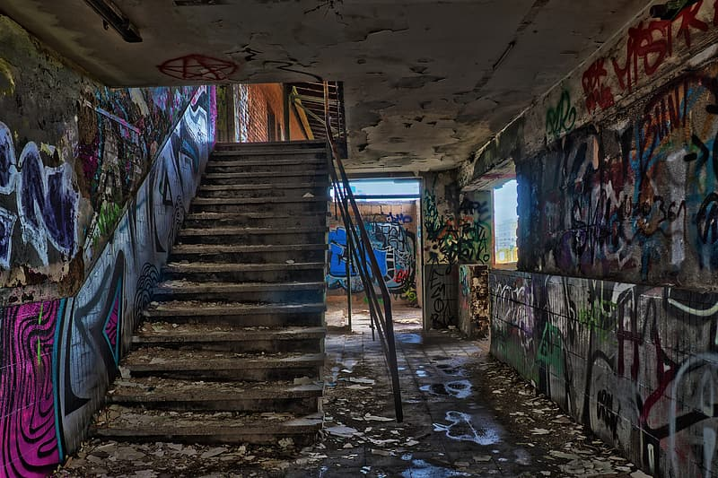 Empty stairs inside building with graffiti walls