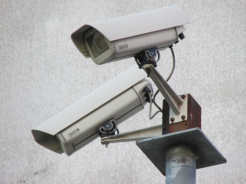Two white bullet security cameras