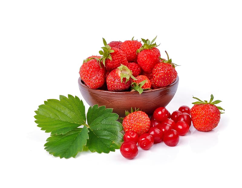 Red strawberries on bowl