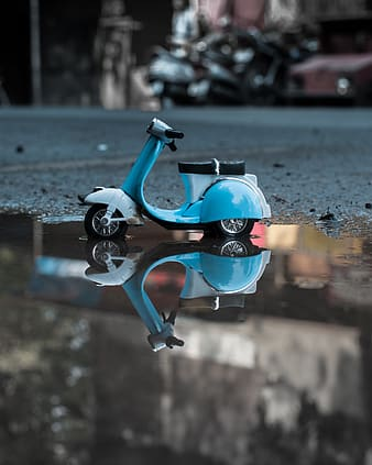 Blue miniature motor scooter on water