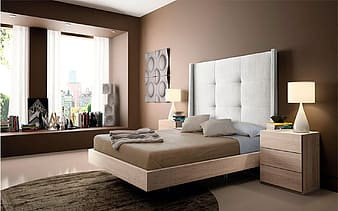 Brown wooden bed frame indoors