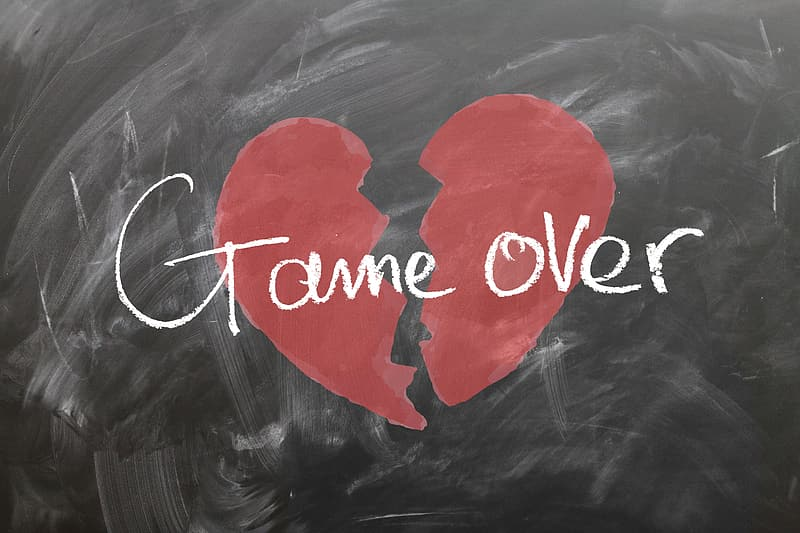 Red broken heart with game over text overlay