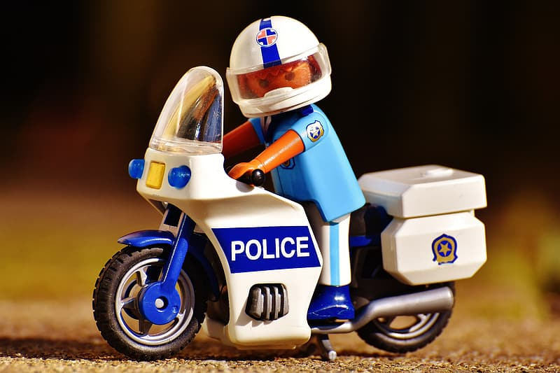 Lego police riding on touring motorcycle miniature