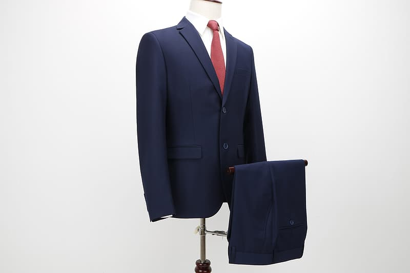 Blue notched lapel suit jacket on torso mannequin