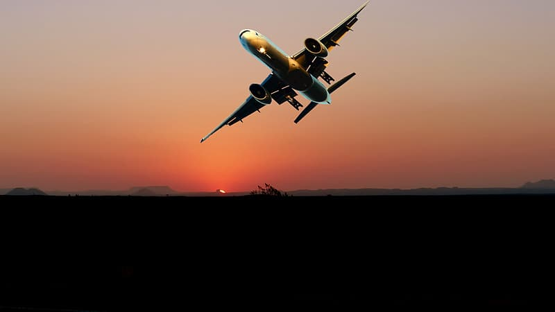 White airplane flying during sunset