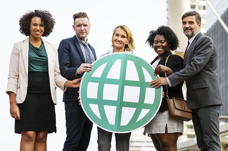 Three women and two women holding globe logo