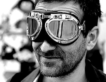 Grayscale photo of man wearing protective sunglasses