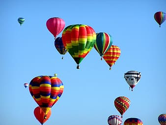 Assorted-color hot air balloons floating at daytime