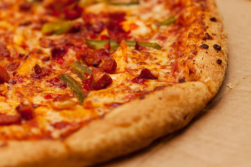 Closeup of bacon and cheese pizza