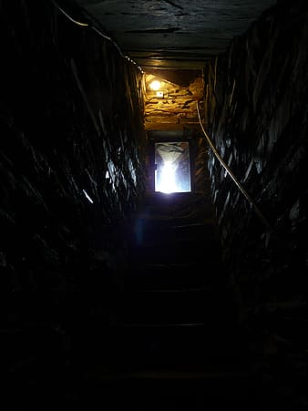 Stairs in tunnel with light turned-on